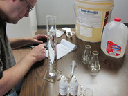 Steve Schiller developing calibration data on titration kits for Power Kleen parts washing detergent
